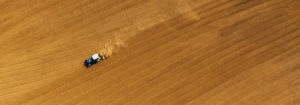field being plowed overhead
